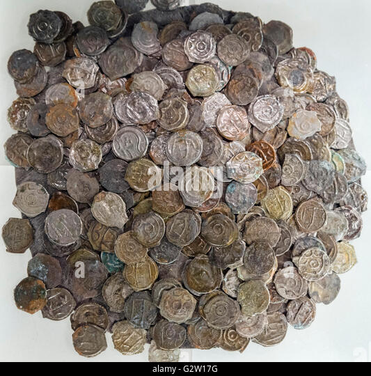 Iron Age high-tin bronze coins from the Sunbury Hoard, c.100-50 BC, found at Shepperton near Sunbury and displayed - Stock Image