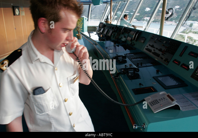 BVI Tortola Holland America Caribbean cruise ms Noordam bridge officer phone - Stock Image