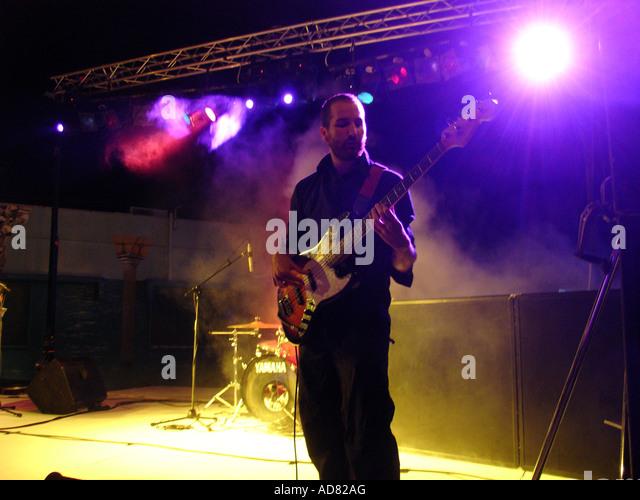 Guitarist playing electric guitar at a rock music concert in Tel Aviv Israel - Stock Image