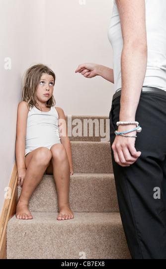 Mother telling off Daughter on Steps - Stock Image