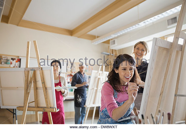 Woman taking adult painting lessons - Stock-Bilder