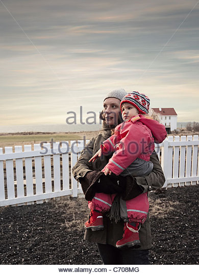 Mother and daughter in backyard - Stock Image