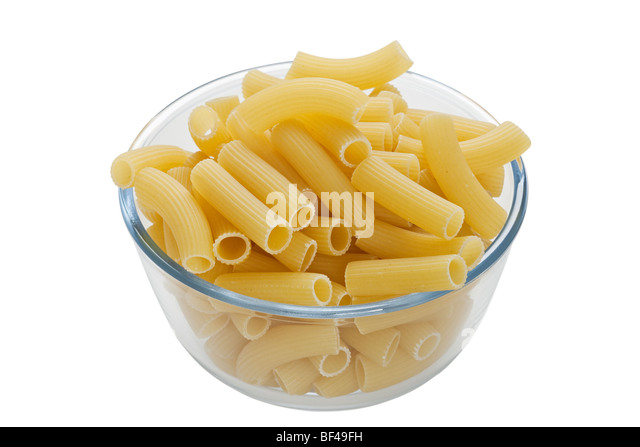 Rigatoni pasta in bowl on white background - Stock-Bilder