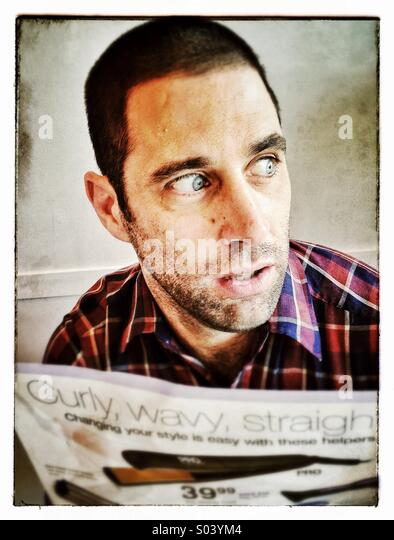 Guy reading the newspaper - Stock Image