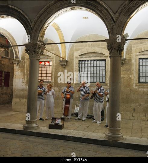 Musician in the Sponza palate, Dubrovnik, Croatia - Stock Image