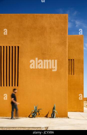Facade detail with walking figure. Laayoune Technology School, Laayoune, Morocco. Architect: Saad El Kabbaj, Driss - Stock-Bilder