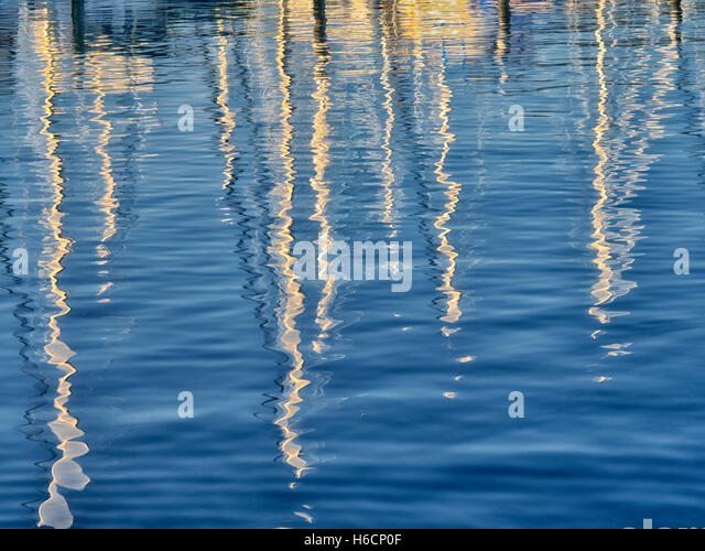Reflected sailing masts at Monterey Harbor and Marina, California - Stock Image