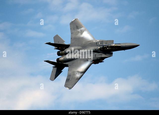 An F-15E Strike Eagle soars through the sky. - Stock Image