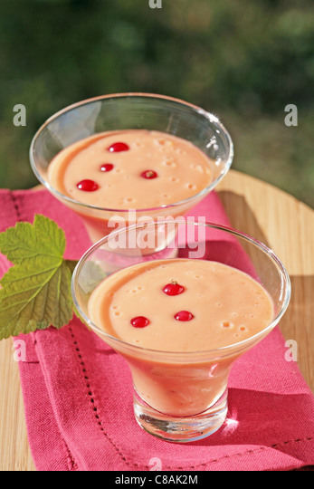 Peach and redcurrant smoothie - Stock Image