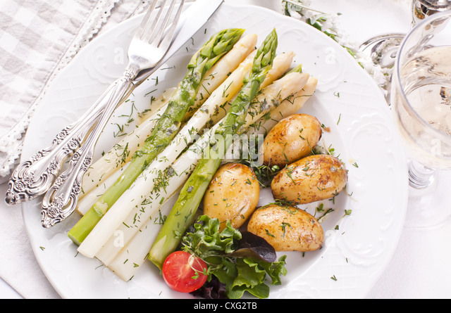 Asparagus with jacked potato - Stock Image