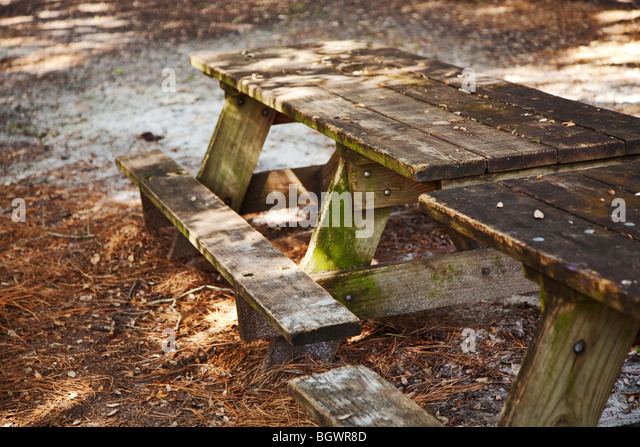 old wooden picnic table on a diagonal angle - Stock Image
