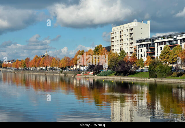 The river Mayenne at Laval with fall foliage trees, commune in the ...