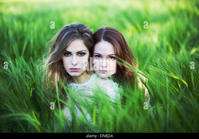 Two women sitting in the cornfield - Stock Image