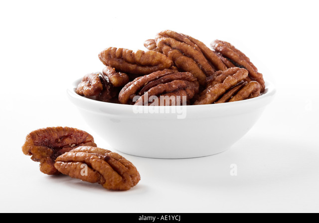 A bowl of candied pecans with white background cutout - Stock Image