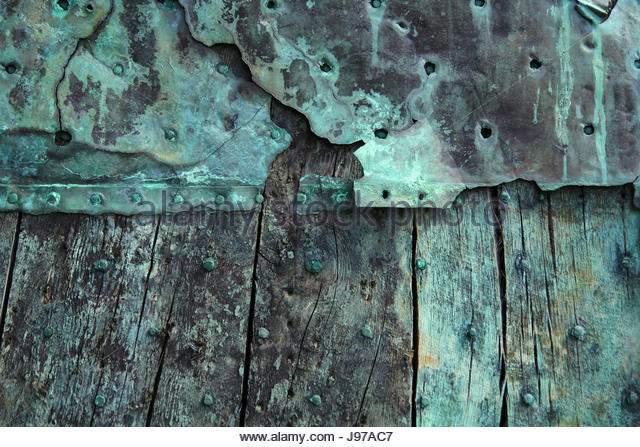 Oxidized copper and decayed wood background. - Stock Image