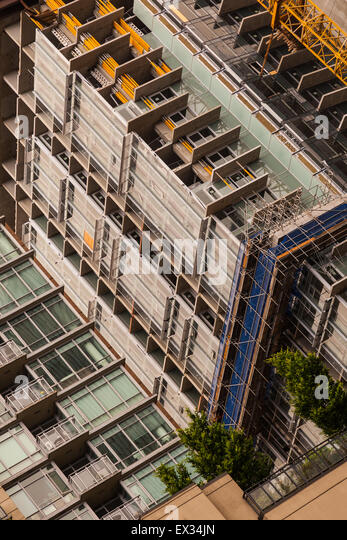 Abstract image of an apartment tower being constructed in downtown Vancouver, Canada - Stock Image