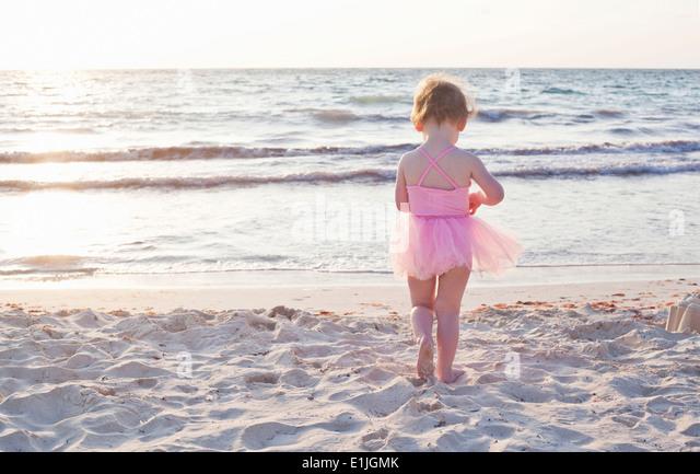 Girl wearing tutu on beach in Tulum, Mexico - Stock Image