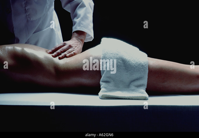 A close up of a woman getting a massage at a health spa. - Stock Image