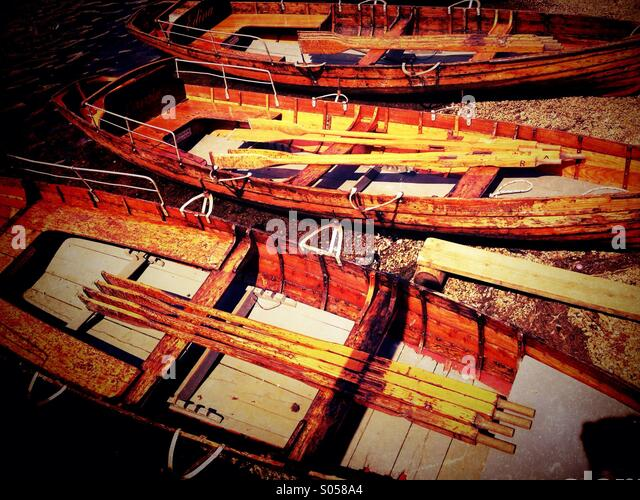 Moored rowing boats on Derwent Water in Lake District - Stock Image
