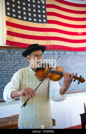 Violinist playing violin at Vermilionville history museum of Acadian, Creole, Native American cultures, Lafayette, - Stock-Bilder