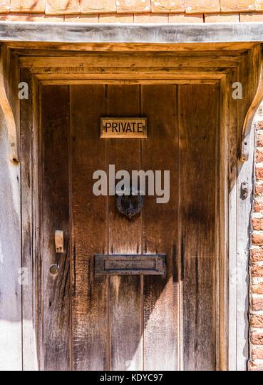 Private wooden door at Sissinghurst Gardens, Kent, UK - Stock Image