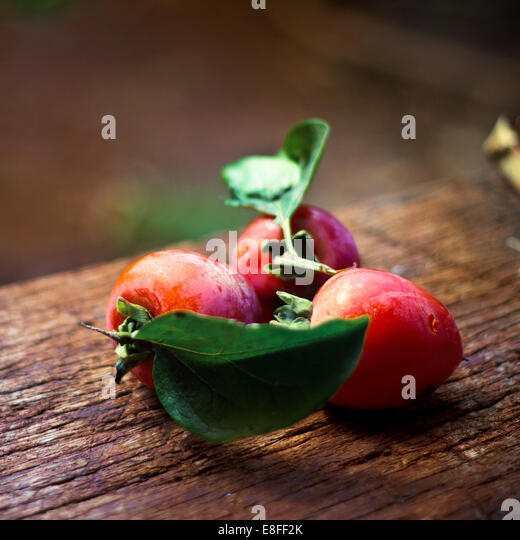 Close up of plums on wooden table - Stock-Bilder
