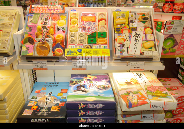 Japan Tokyo Narita International Airport NRT gate area concourse shopping candy cookie for sale retail display chocolates - Stock Image