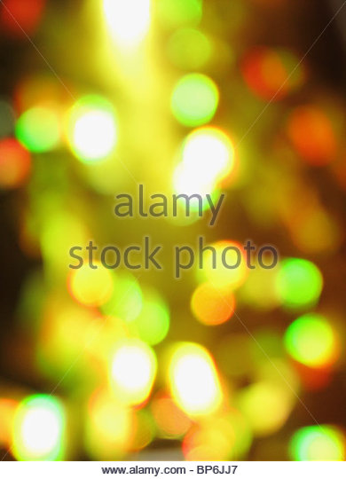An abstract image of yellow, green and red lights - Stock Image