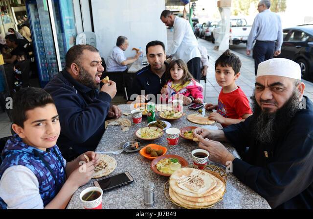 Traditional Jordanian breakfast- Hummus, Falafel and Pita bread served in a very popular restaurant in Aqaba, Jordan. - Stock Image