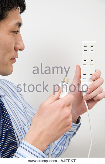 Man with extension cord - Stock Image