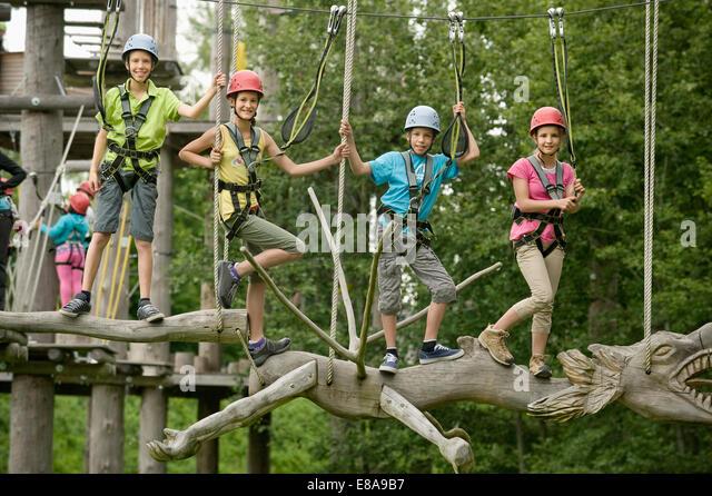 Childrens climbing on crag - Stock Image