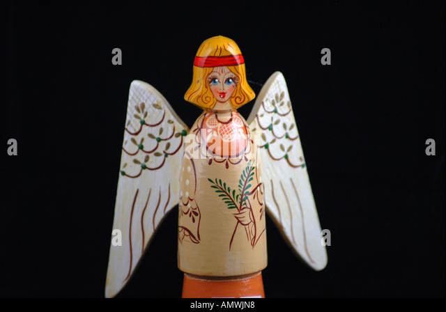 Christmas ornament carved wooden angel - Stock Image