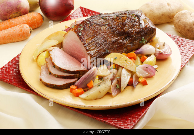 Close up of roast beef and vegetables - Stock Image