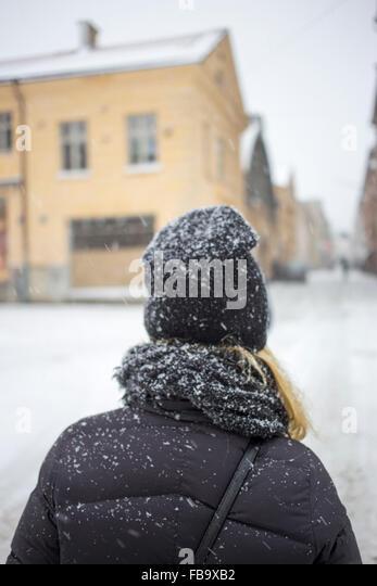 Sweden, Vastergotland, Gothenburg, Rear view of woman standing in street - Stock Image