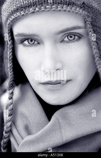 Portrait of a beautiful young woman wearing a woolen hat and looking at camera - Stock Image