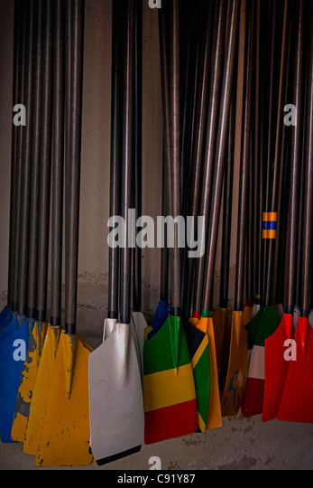 several rudder hung on the wall, painted in color - Stock Image