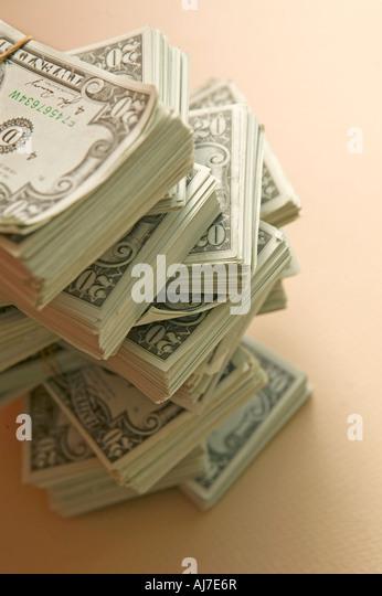 money cash bundle rich wealth savings - Stock Image