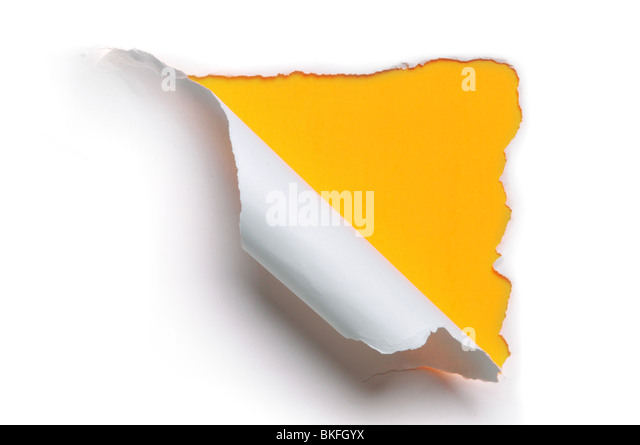 ripped white paper against a yellow background - Stock Image