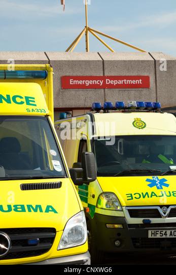 Emergency ambulances parked outside accident and emergency department of Royal Bournemouth Hospital - Stock Image