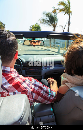 Young couple driving convertible, San Diego, California, USA - Stock Image