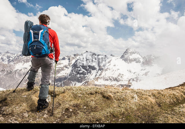Young man looking at view in Bavarian Alps, Oberstdorf, Bavaria, Germany - Stock-Bilder