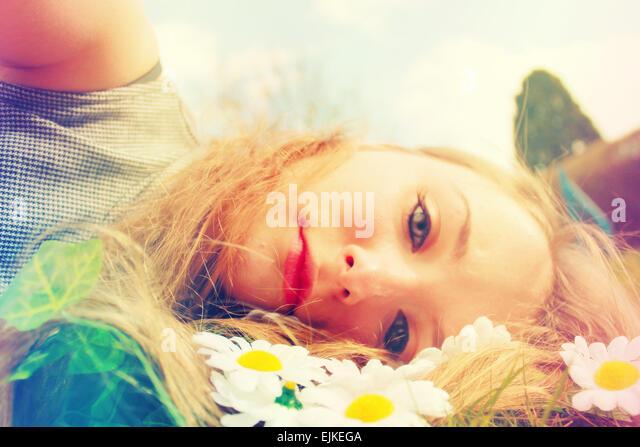 daydream, daydreaming, fantasy, teenager, teenager photo-shoot, male-uk, make-uk, flowers, flower-girl, story, - Stock Image