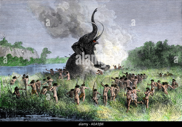 Prehistoric wooly mammoth hunters using bows and arrows - Stock-Bilder
