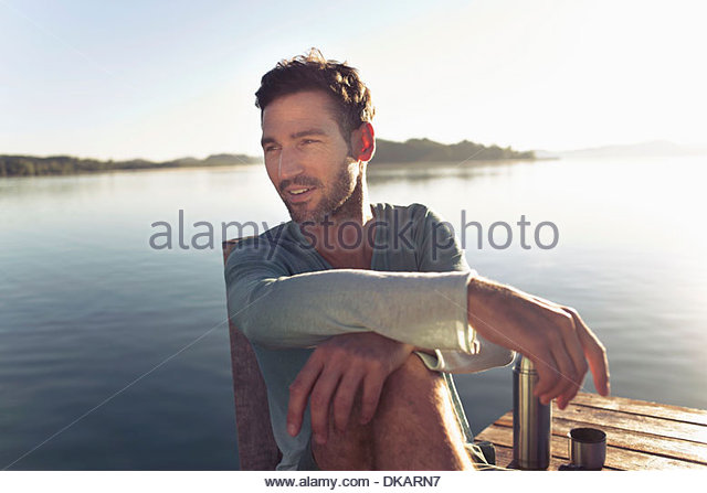 Portrait of mature man by lake, Munich, Germany - Stock Image