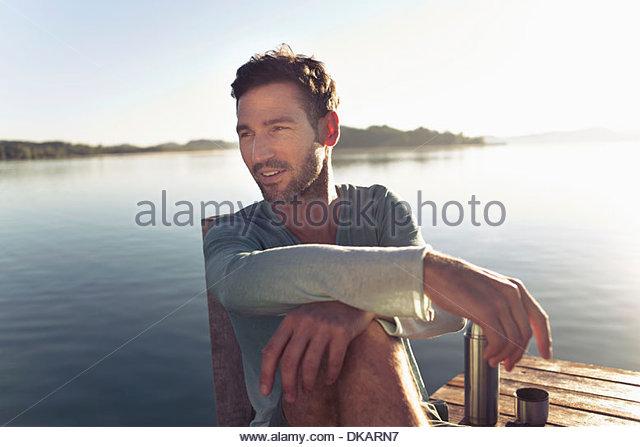 Portrait of mature man by lake, Munich, Germany - Stock Image