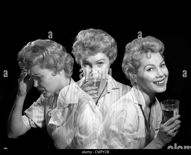 1950s 1960s MULTIPLE EXPOSURE WOMAN WITH A HEADACHE TAKING MEDICINE AND SMILING WITH EXPRESSION OF RELIEF FROM PAIN - Stock Image