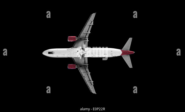Passenger Jet seen overhead - Stock Image