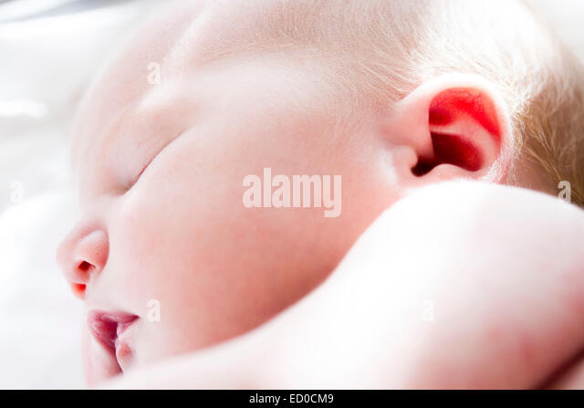 Close up of sleeping newborn (0-1 months) girl - Stock Image