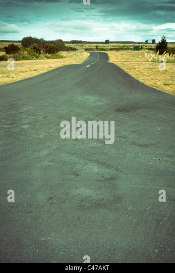 Abstract retro toned image of wide road. - Stock Image