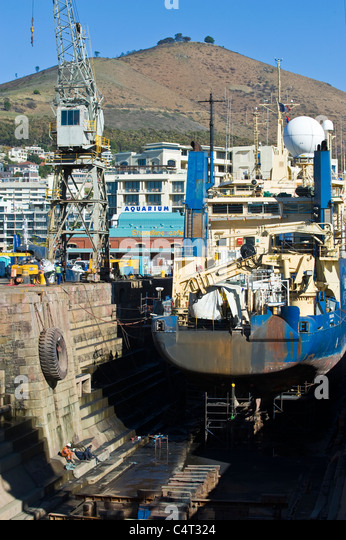 Ship in a dry dock for repair and inspection Cape Town South Africa - Stock Image